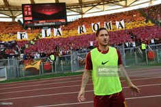 AS Roma's legend Francesco Totti poses with fans in the background before the Italian Serie A football match AS Roma vs Genoa on May 28, 2017 at the Olympic Stadium in Rome. A sold-out Stadio Olimpico is set to bid farewell to iconic club captain Francesco Totti, 40, when he brings his 25-season career with Roma to an end today. Although Roma won only one of their three league titles in Totti's time at the club, he has scored 307 goals for Roma, 250 of which came in Serie A. / AFP PHOTO…