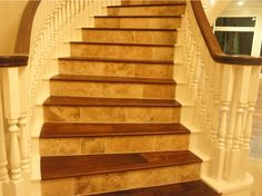 Tuscan's Hickory Sienna in the steps corresponds well with the tile color.  #stairs #home #hardwoodfloors #flooring #wood #JohnsonPremiumHardwood