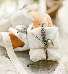 bread wrapped and tied with lavender - you could use this idea for wrapping and taking scones or other homed-baked goods as a gift, also.
