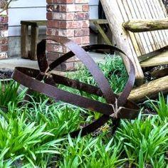 http://www.funkyjunkinteriors.net/2016/03/funky-garden-junk-orb-thanks-to-a-broken-barrel.html
