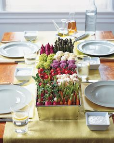Create an hors d'oeuvre centerpiece that recalls a vegetable patch. Buy a large, deep galvanized-metal planter from a garden-supply center, line the bottom with sprouts, and pour in enough water to moisten them. Arrange vegetables, such as cherry tomatoes, carrots, radishes, asparagus, and cauliflower, in sections inside the container, varying the colors. Serve immediately with herb dip, or cover with moist paper towels and refrigerate up to 2 hours.Herb Dip Recipe