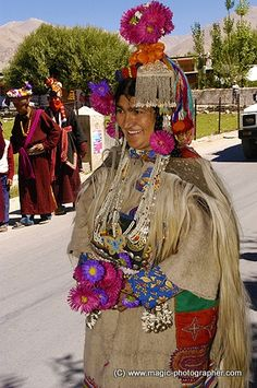 Woman Dard or Brokpa tribe from Dha Hanu Village in color clothes and flowers Ladakh Kashmir Indi