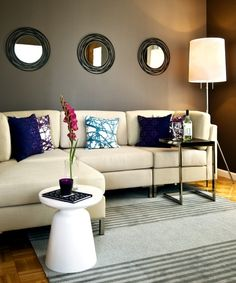mirrors above couch