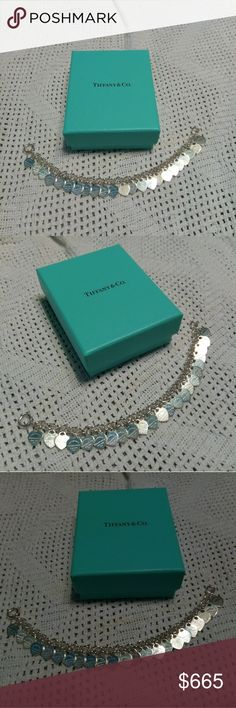 "Tiffany & Co.Mini heart dangle bracelet Motivated seller!!!!  This bracelet is cheaper on E B or M C  Tiffany & Co.  Mini Heart bracelet  New never worn   925 sterling silver mini heart dangle bracelet  8""  It comes with new Tiffany Box  Authenticity is 100% guaranteed    Motivated to sell!! cheaper on E B or M C Tiffany & Co. Jewelry Bracelets"