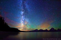 Starry night sky and Milky Way over Jackson Lake and Tetons, Grand Teton National Park.