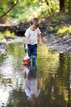 ~ ...Sunday afternoons at the park with him & his boat....discovering new, hidden creeks to wade in....watching the little ones catch crawdaddies & frogs around the crawdad hole, with such amusing faces...senses & imagination at play!