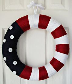 Yarn Wreath, wouldn't this also be great for summer in a watermelon design? Alternate light and dark green narrow stripes for the red and white area and substitute pink with black seed-shaped beads.  Sooo doing both!!!