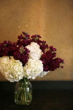floral idea, I like a lot of white with green and maroon accents :)