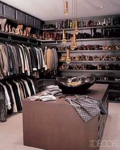 CHIC CLOSET In jeweler Loree Rodkin's Los Angeles apartment, decorated by Martyn Lawrence-Bullard, the deep-hued dressing room features an island of drawers and shelving by Poliform.