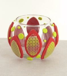 This modern votive holder is the perfect way to add a punch of color to any décor.