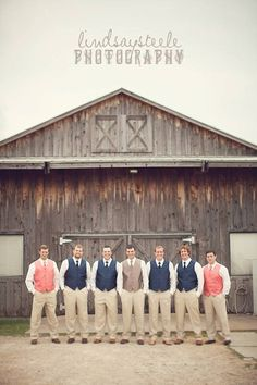 How adorable are these navy and coral vests on these groomsmen? {Rock Creek Ranch Event Center}