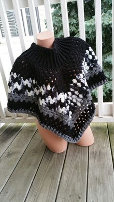 Hot Off My Hook! Project: Cowl-Neck Poncho Started: 20 June 2015  Completed:  22 June 2015 Model: Micole the Mannequin Crochet Hook(s): J, Cowl portion, J, Granny stitch portion Yarn: Redheart Super Saver  Color(s): Black, Zebra, &  Grey Heather Pattern Source: Simply Crochet Magazine Issue No. 25 Pattern Design: Simone Francis Notes: This my 7th Cowl-Neck Poncho! No fringe, but I did shorten the cowl portion. I did 3 rows of the border.