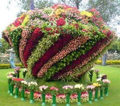 Amazing number of flowers! www.MartinSalesGroup.com likes this! The people in the background show the proportional size of this arrangement.