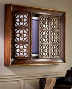 Quatrefoil Flat-Screen TV Entertainment Cabinet Need the perfect way to disguise your television? The John-Richard Quatrefoil Wall Mounted Television Cabinet Bi-Folding Doors With Antique Mirrors Behind Gothic Quatrefoil Panels Set Within A Cavetto Mounde Armoires Murales Tv, Tv Entertainment Wall, Entertainment Centers, Entertainment Products, Tv Escondida, Deco Tv, Wall Mount Tv Stand, Tv Wall Cabinets, Television Cabinet