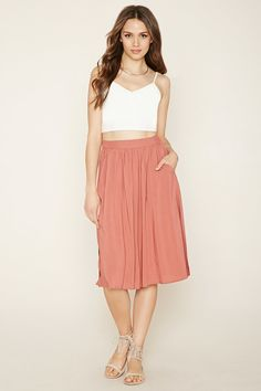 Forever 21 Contemporary - A woven skirt featuring slanted front pockets, high side slits, and an elasticized back waist.