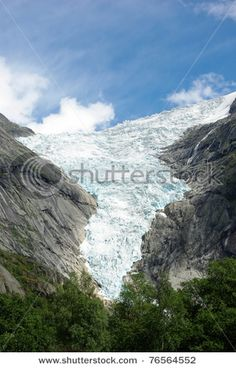 Mountain river flowing from glacier Briksdale in Norway, Europe
