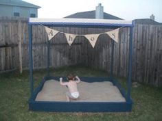 This but instead of a sandbox, make a giant dog bed w/washable cover