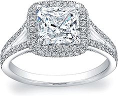 Radiant, princess, or ascher split shank halo diamond ring (NO pillow). Diamond flush with halo, not above. Center stone over 1 carrot. At least VS 1, F