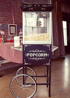 We love the vintage popcorn machine from @POSH Couture Rentals in the Emily Clarke Events tabletop featured in the Fall/Winter 2012 issue of Brides of North Texas. Photo by Sarah Kate, Photographer #wedding #bridal #vintage