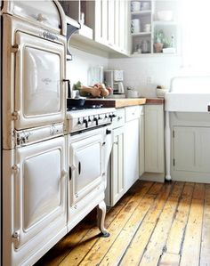 Antique stove and ice box = love  (Now the question is, does it work?)