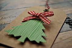 christmas gift tags set of four christmas gift tags on heavy kraft paper. these tags have raised green & white trees, a red gingham bow, metal eyelet, & bakers twine. handmade kraft christmas.