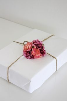 The perfect touch to wrapping a gift ~ use the birth flowers of the month a person was born in, or the month of the occasion (i.e. Christmas).