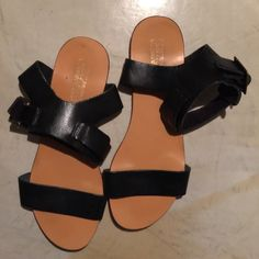 Deena & Ozzy black sandles Single black leather strap over the toes. Single strap over the ankle with leather backing. Thin and flat, very lightweight to throw in your handbag. Deena & Oozzy Shoes Sandals