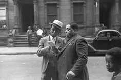 Charles Peterson - Jazz musicians Willie 'The Lion' Smith and Fats Waller look at letters in their hometown of Harlem, New York, May 1937