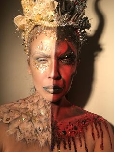Half angel, half devil makeup, handmade headdress. Instagram: Geoartistry Glitter by the Gypsy Shrine, paints by Mehron. Angel body paint face paint and jewels, demon blood drips and gems. SFX makeup, special effects makeup.