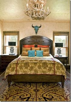 Beautiful gold, orange, and turquoise western guest bedroom.
