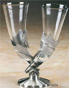 Awesome. Entwined weeding beer glasses(drinking horns). Unity ceremony?                                                                                                                                                     More