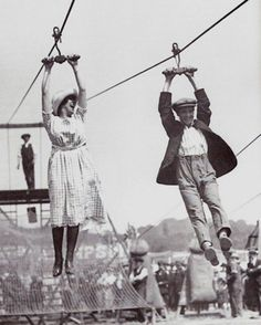 A couple enjoys a old style zipline in 1923