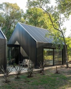 morini black house, 'la negrita,' is nestled among a forest in argentina