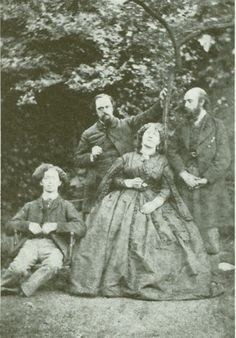 Algernon Charles Swinburne, Dante Gabriel Rossetti, Fanny Cornforth and William Michael Rossetti at Cheyne Walk. 1863.