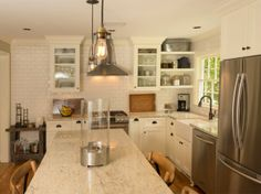 1940s Cottage Kitchen Make-Over, This 1940s kitchen make-over took the small original galley kitchen and dining room and opened up the two rooms as one large functional eat-in kitchen.  With custom made cabinets and a distressed island, the new kitchen is quaint, relaxed, and perfect for entertaining.  White subway tiles, a farm house sink, window seat, book shelves, and an old barn door as focal points, this new kitchen is a breath of fresh air. , Kitchens Design