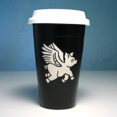 FLYING PIG Travel Mug - BLACK - Double Wall Ceramic Stoneware. Microwave-safe and dishwasher-safe. We carved all the way through the shiny glaze of this double walled reusable ceramic travel mug so that the bold natural stoneware can be seen. Includes white silicone lid. Other colors may be available. Food-safe! Glaze you can feel good about: meets CA's Prop 65 limits for leaching of lead & cadmium (0.99 ppm lead and 7.92 ppm cadmium). In fact, our glazes are non-detect at testing…