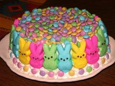 Darling Easter cake. Cake & frosting flavor, your choice- strawberry, lemon, white or yellow. Use M & M's, jelly beans or Skittles for the sides & top. Coconut dyed green for grass.