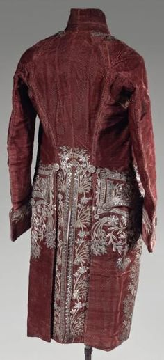 Rear view of Court Costume, Louis XVI, cut velvet. Garnet color velvet decorated with small pellets and embroidered on the collar, the front, the back, under the pockets and along the Basque with flowers and foliage. Trimmed with sequins of silver and gold and pellets and round shaped faceted glass, embroidered buttons, lining of white silk. Photo Thierry De Maigret