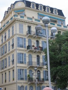Old apartment building with penthouse in Cannes French Apartment, Old Apartments, Cannes, Parisian, Home Goods, House Ideas, France, Mansions, House Styles