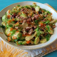Fall Harvest Brussels Sprouts 1 tsp. olive oil 1 tsp garlic, minced 3 cups Brussels sprouts, shaved 1 cup carrot, grated 1 small pear, cut into thin matchsticks 2 tbsp. orange juice 1/4 cup dried cranberries 2 tbsp. candied pecans, chopped small