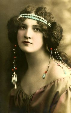 Lovely bandeau. Hand coloured photograph./i think the earrings are part of the headband