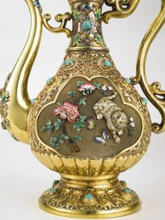 A Chinese Export silver-gilt, enamel and hardstone coffee set with matching tray, mid 20th century all with enameled flower and foliate decoration and set with turquoises, comprising a Coffee Pot applied on both sides with an enameled cat chasing butterflies among flowers, eight Cups applied on both sides with enameled peonies, and a matching two-handled Tray. 10 pieces. marked on bases SILVER