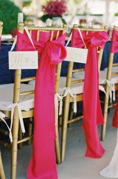 """""""Mr."""" and """"Mrs."""" sign on the back of the groom and bride's chair at the reception or rehearsal dinner."""