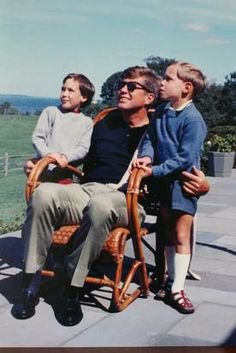 President John F. Kennedy with Maya and Cecil Auchincloss taken at Hammersmith Farm. The children were about four years old at the time.