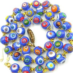 Check out this item in my Etsy shop https://www.etsy.com/listing/495876171/blue-millefiori-glass-bead-necklace