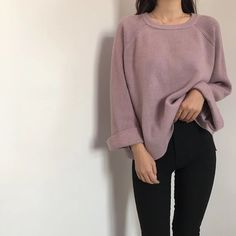 someone holding the hem of their sweater, purple, grey, black