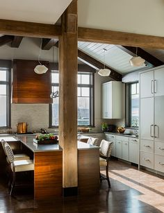 Wood beams and a combination of white and dark wood in kitchen