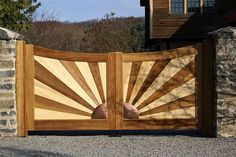A sunburst detail can bring a period feel to a leading to a home. Wood Fence Gates, Wooden Gates, Front Gates, Front Yard Fence, 1930s House, Timber Deck, Driveway Gate, Deck Railings, Exterior Doors