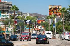 I hate LA, but I love Sunset Blvd.; I always hear The Doors in my head when I'm there. . .
