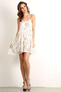 Spaghetti strap, floral print drop waist a-line dress. Details Fabric: 100% rayon